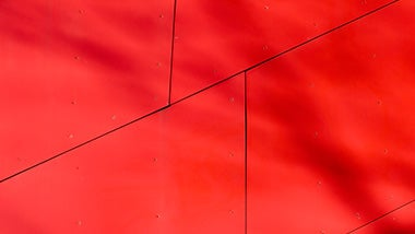 a red wall with black lines